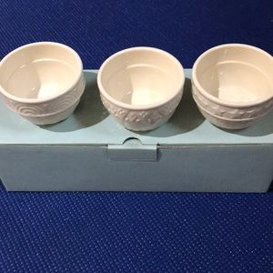 Set of three PartyLite votive holders.